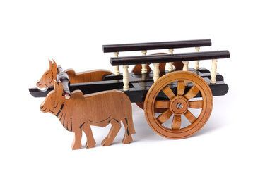 This #woodenbullockcart is best pick for gifts, especially  in wedding ceremony  One can't resist Excellent pick for Home décor and as Gift article. Looks well in Living room, office or any table platform.   This wood make is made from 100% natural colors and is made by rural artist of India