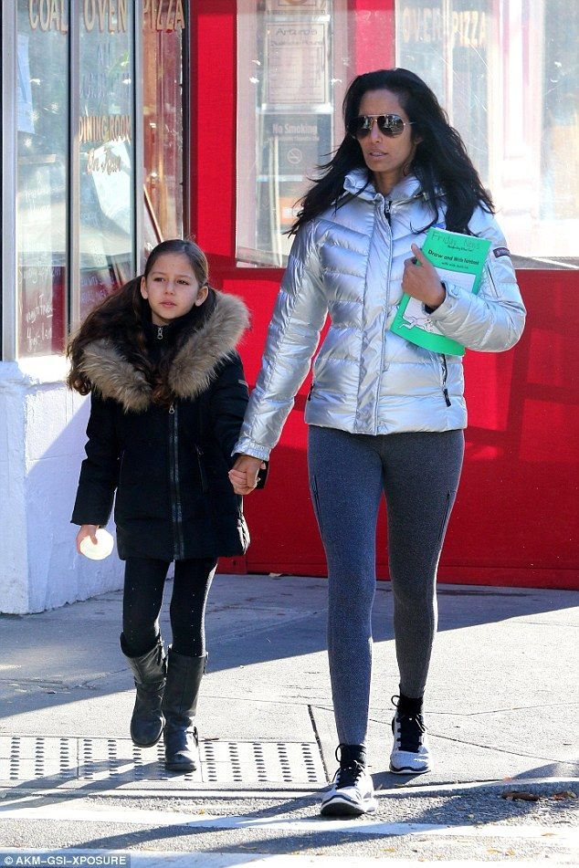 Stylish duo:The Top Chef host wrapped up warm in a white fur coat and grey leggings as she strode side by side her mini me