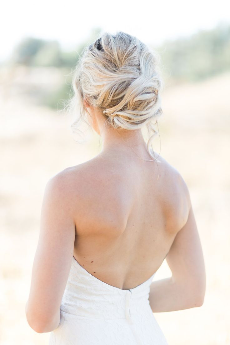A boho and romantic updo hairstyle for this stunning LA bride. Emily Lynn + Co. provides bridal hair + makeup services all over Los Angeles, Orange Co...