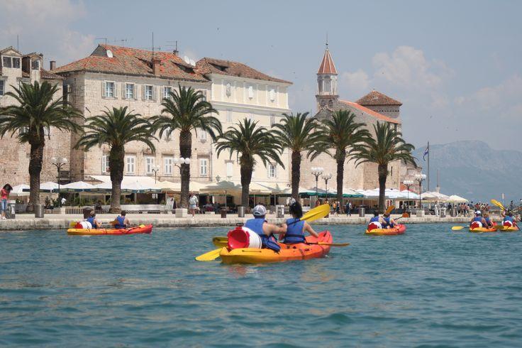 Sea kayaking along the promenade in Trogir near Split city
