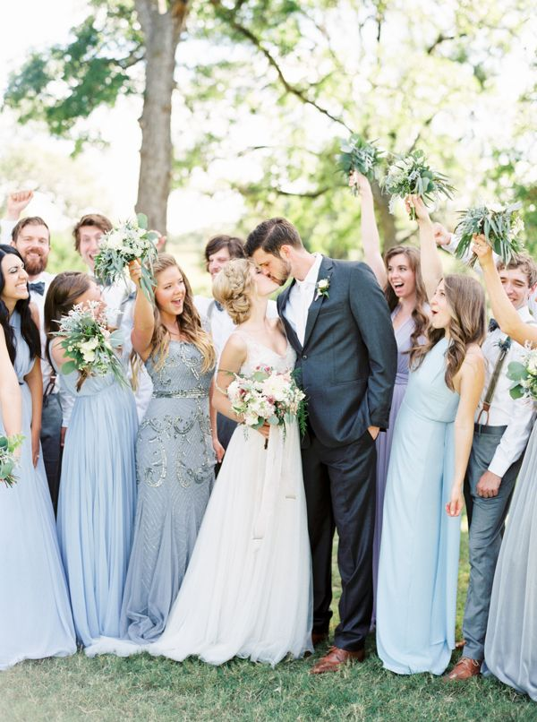 What a happy looking bridal party! I love all the mismatched bridesmaid dresses