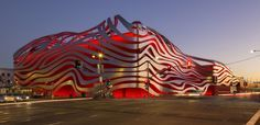 The Peterson Automotive Museum reopens in Los Angeles, with Ferrari red ribboned facade and all.