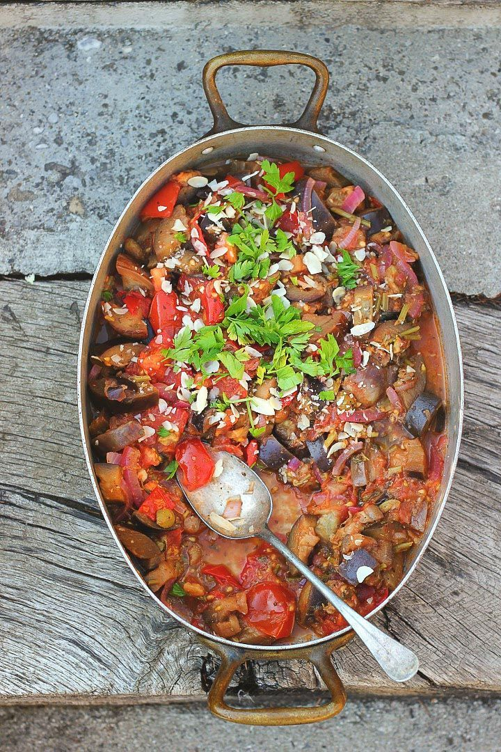Sicilian Eggplant Caponata with Grilled Polenta Wedges. Warm, stewy eggplant and tomatoes with all the Italian flavors. Vegan and Gluten Free.