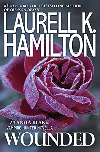 Wounded (Anita Blake, Vampire Hunter) by [Hamilton, Laurell K.] Publisher: InterMix (December 6, 2016)