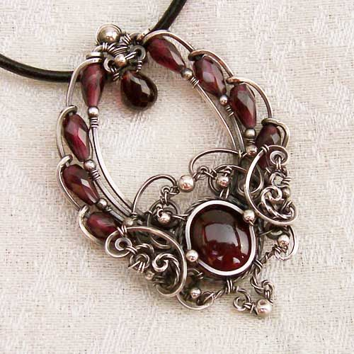 The wire work on this pendant is exquisite! I wish I had these skills. Time Traveler Silver Garnet Pendant by *Wiresculptress