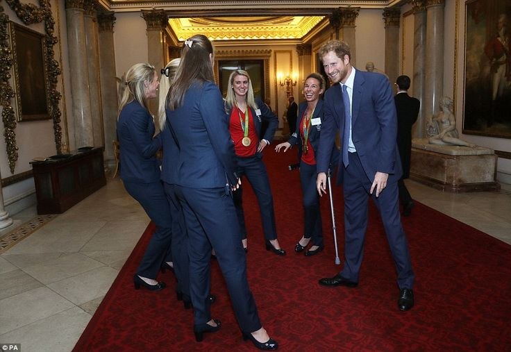 The fifth-in-line to the throne could be seen  giggling and sticking his tongue out as he chatted to the Team GB women's hockey team at the Buckingham Palace reception today.