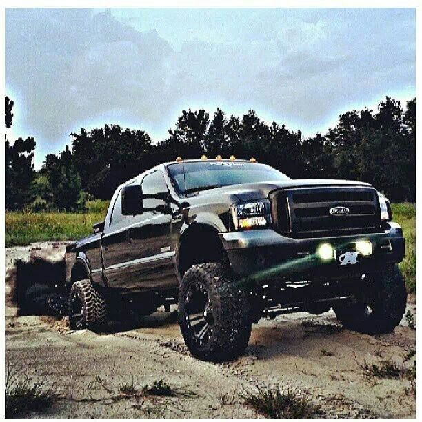 Lifted Black Ford Powerstroke ROLL COAL