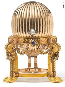 ...treasure found -- the 33 million dollar Faberge egg -- 8.2 centimeter (3-1/2 inch) egg on an elaborate gold stand supported by lion paw feet with three sapphires that suspend golden garlands...