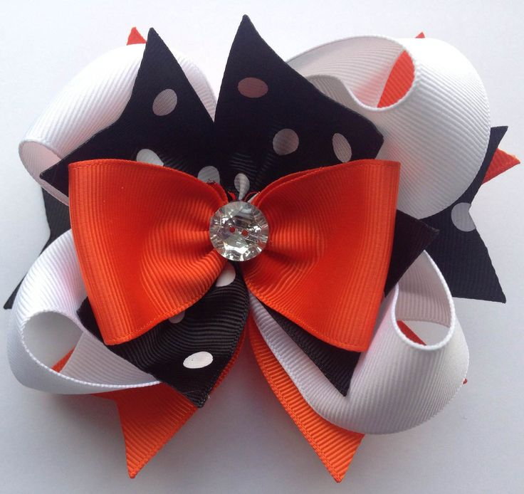 These lovely bows by Forevher Designs are made to match our most popular girls outfits! Bows are created with grosgrain ribbon and center jewel, and are fastened with an alligator clip. Ends are heat