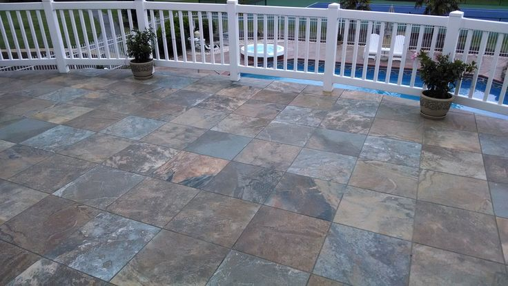 An upstairs patio is the perfect place for multi-colored slate... but only when it's installed by experienced craftsmen. What's under the tile is KEY in this type of work.