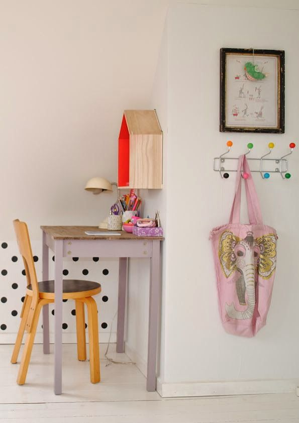 eclectic kids room with white walls, black polka dots, yellow chair