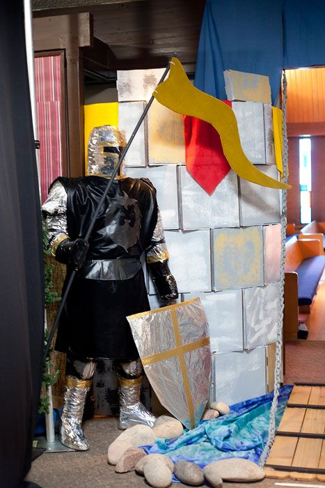 Kingdom Rock decorating flag is cardboard covered with cloth. Knight chicken wire, wrapped around cardboard cut out of man.