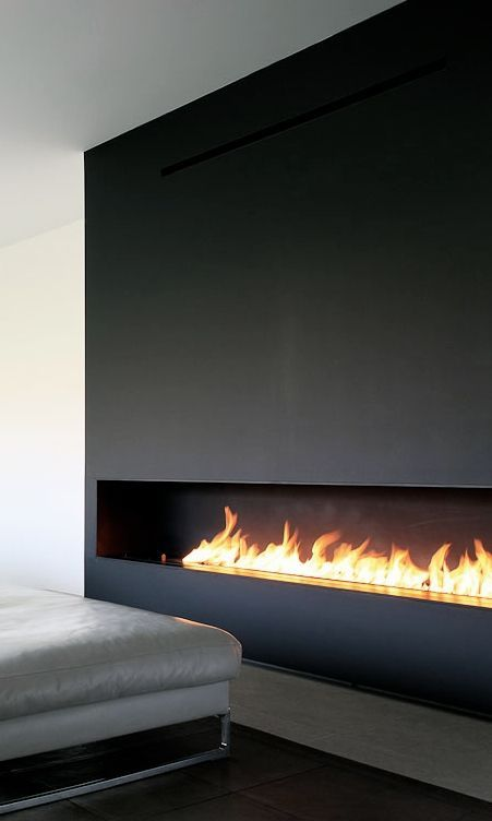 Long, horizontal fireplace in dark wood.