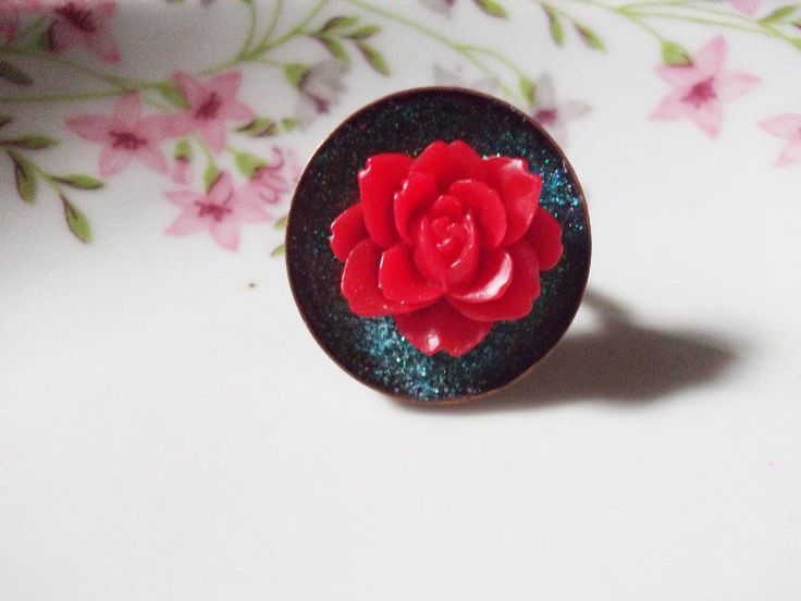 red rose with blue green fairy dust ring