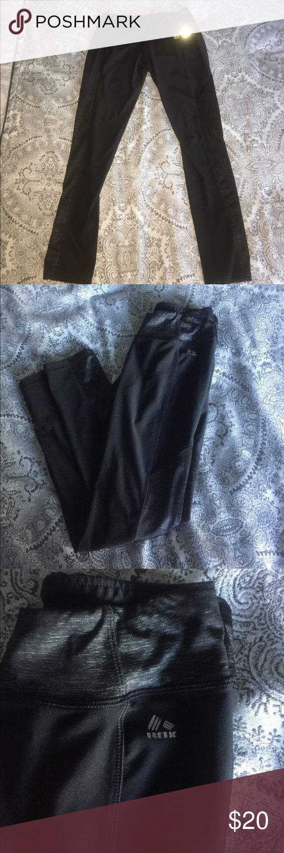 Black and Silver leggings Super cute and comfy black and sliver workout leggings. The logo is starting to come off but other than that these pants are in great condition. Have been worn and washed multiple times. I just don't wear them anymore. Reebok Pants Track Pants & Joggers