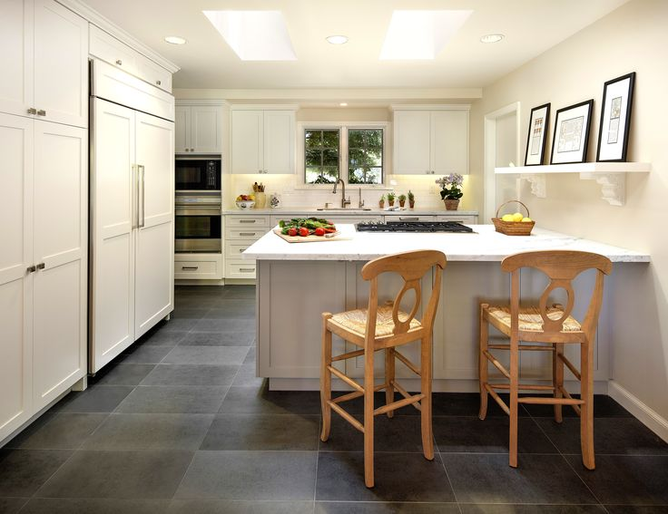 Love the dark tile floor against the white cabinets!  What a great working island too!