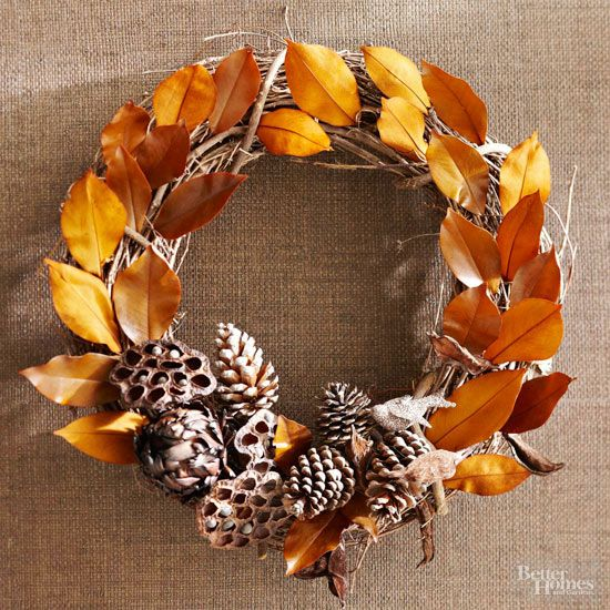 brown-and-gold arrangement. Wire dried artichokes, lotus pods, and pine cones to the bottom of a grapevine wreath. Tuck brown and gold leaves between the wreath's twigs, securing with hot glue if needed.