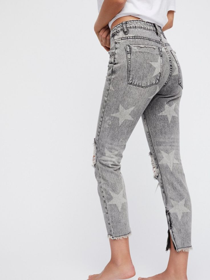 High Waisted Star Freebirds | High-rise straight leg jeans featuring a subtle allover star print.    * Ripped knees   * Zip closures on the hem   * Raw hem and allover distressed detailing   * Five-pocket style