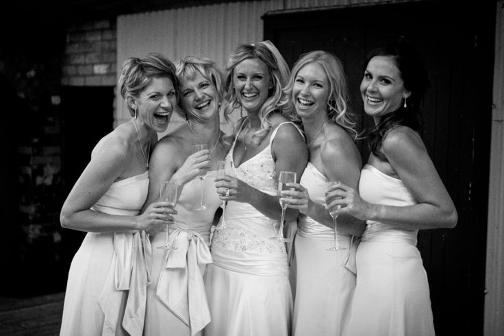 Bride and her bridesmaids at a wedding at home at Milford beach, Auckland. Black and White.  beguiling fine art family photographs for the walls of the most discerning clients homes. We specialise in wedding and family portrait photography, and supply prints on the highest quality media, framed in beautiful conservation standard frames. We are a high end studio located in the beautiful city of Auckland, New Zealand.