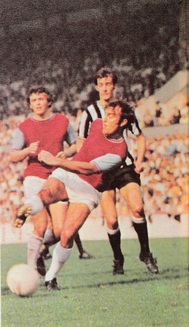 19th September 1970. West Ham United inside forward Jimmy Greaves in action against Newcastle United, watched by team mate Trevor Brooking and Keith Dyson.