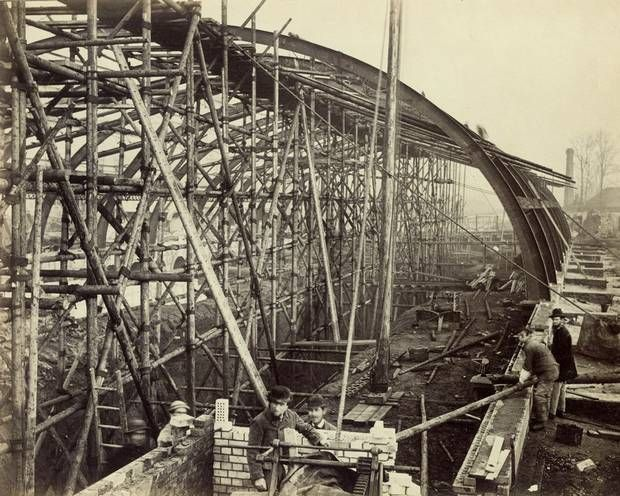 Gloucester Road Station under construction looking towards South Kensington, in 1866. Timber scaffolding method of erecting the metal arched ribs, assembled in sections and built up to the timber