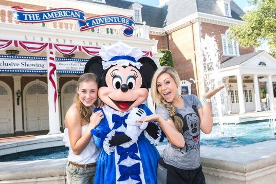 New country music duo Maddie & Tae -- Maddie Marlow (left) and Tae Dye (right) -- pose with Minnie Mouse Aug. 16, 2014 at The American Adventure pavilion at Epcot