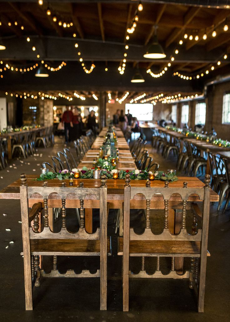 Lonng wooden tables and bistro lights for