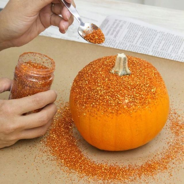 Don't like carving? No prob. Make a cute glitter pumpkin instead! ... Good Idea...very affordable, pumpkins are so cheap in the fall....most expensive part is the glitter.