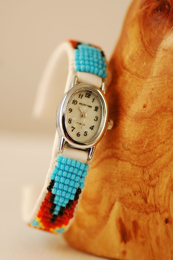 This multi-colored seed bead watch bracelet is designed and handmade by Sylvia Spencer, Navajo.  The