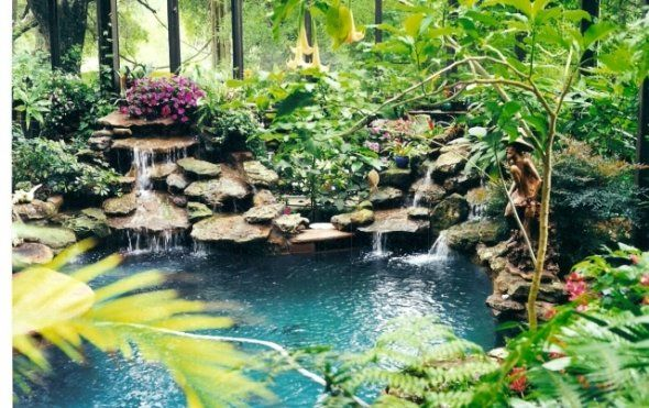 This beautiful greenhouse had multi levels and tropical for Tropical pool gardens