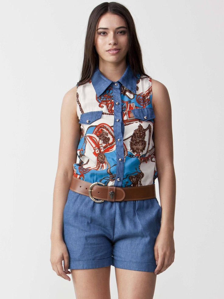 Kirstie - Blue Jumpsuit with collared neckline.  Sleeveless styling with dual front pockets.  Button up front and rear pockets. $66.00