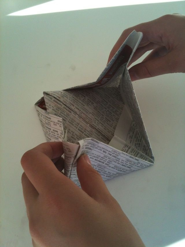 Pull the corners apart then open.