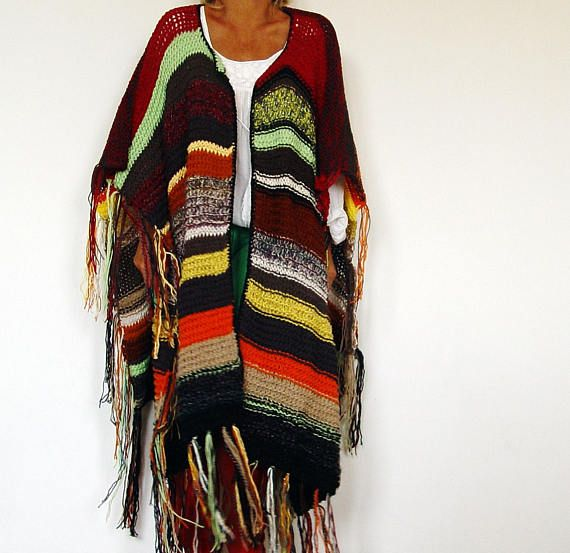 Very unique hand knitted poncho. Mixed yarn types (all soft and cozy) and colors. Perfect to snuggle up with. Play wearing it in many different ways... and look always fabulous! Measurements ( flat taken ): Lenght: 85 cm = 33.5 Lenght with fringes: 110 cm = 43.3 Width: 104 cm = 40.9