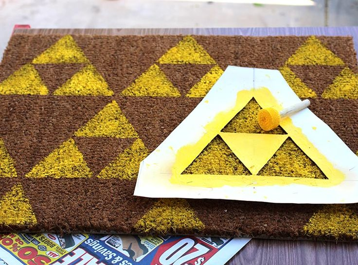 Geek Decor: DIY Legend of Zelda Welcome Mat. I know what I will be doing next week while the boo is at work :D