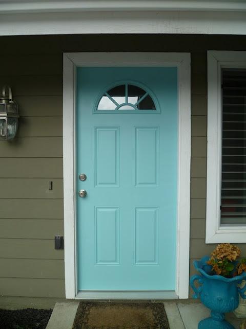 front door color- aqua front door! plant yellow, pink or red flowers in pot to accent?