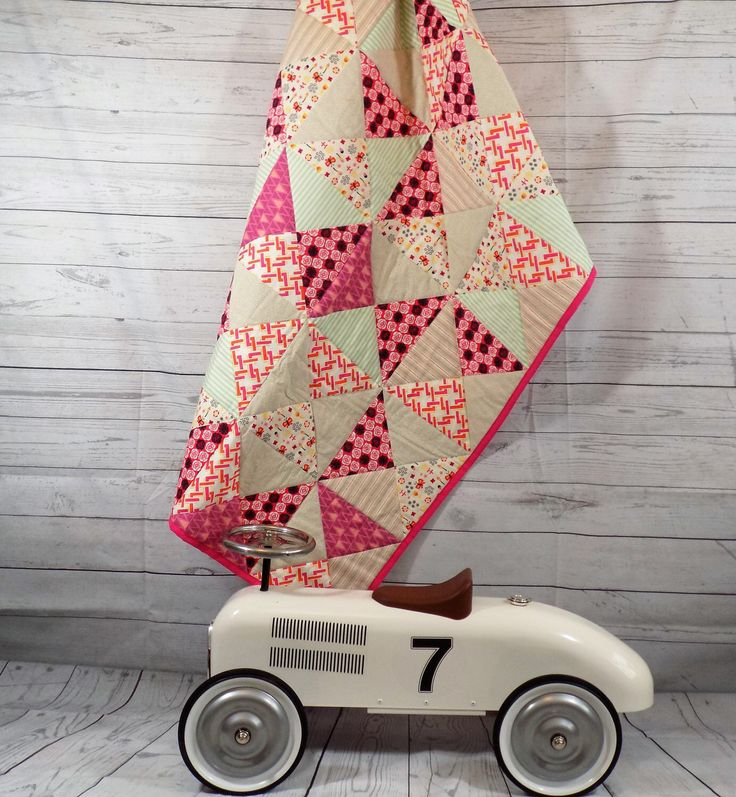A personal favourite from my Etsy shop https://www.etsy.com/uk/listing/268707050/baby-quilt-pink-baby-blanket-boho-baby
