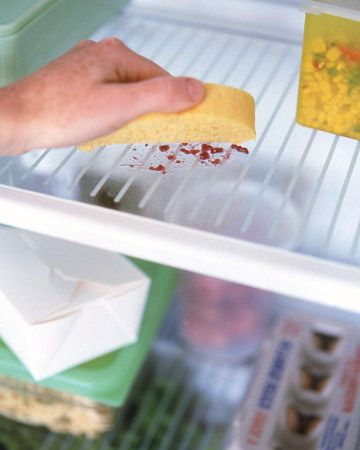 Cleaning a Refrigerator: Every few months, wash the interior with a solution of two tablespoons of baking soda for every quart of warm water. Wash removable shelves and drawers in the solution (let glass shelves come to room temperature first so warm water won't crack them). Use a toothbrush to scrub crannies. Twice a year, vacuum or brush dust from the condenser coils to keep the system from overheating.
