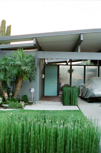 Mid-century modern Eichler home - Orange California. Turquoise front door and horsetail reeds.