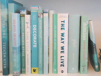 Coastal interior design book stack in shades of  sea foam.