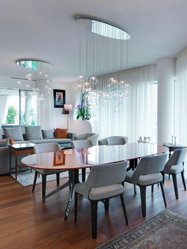 Apartments:Modern Interior Design In Living Room With Brilliant Cascading Chandeliers Also Dining Sets With Stuning Dining Table With Laminate Counter Tops Also Sofas Also Rugs Also White Curtains Modern Interior Design of Luxury Apartment in Milan To Inspire You
