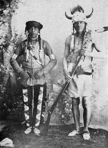 """""""Calf Child"""" and his father, """"Fine Day"""" (aka John Fine Day) men of the Cree Nation, 1896. No additional information."""
