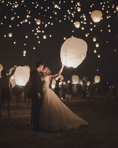 Sky lanterns make a magical wedding send off - and a pretty beautiful portrait too! Seen on @swoonedmag | Photography: @_beyond_the_darkroom_ | Bride's Dress: @allurebridals