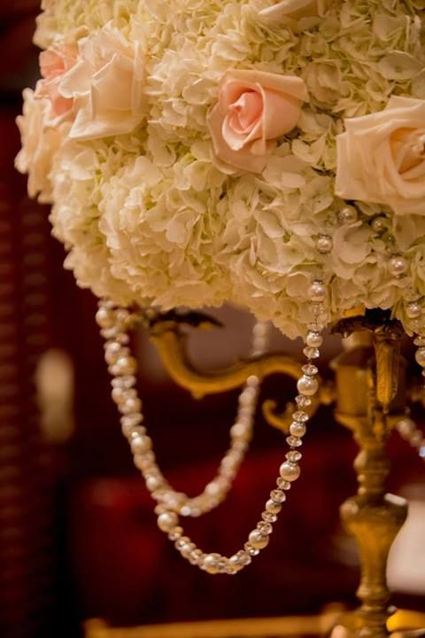 Centerpieces. White Hydrangeas. Blush Pink Roses. Ivory Roses. Topiary Arrangement. Pearls Garland. Gold Candelabra.
