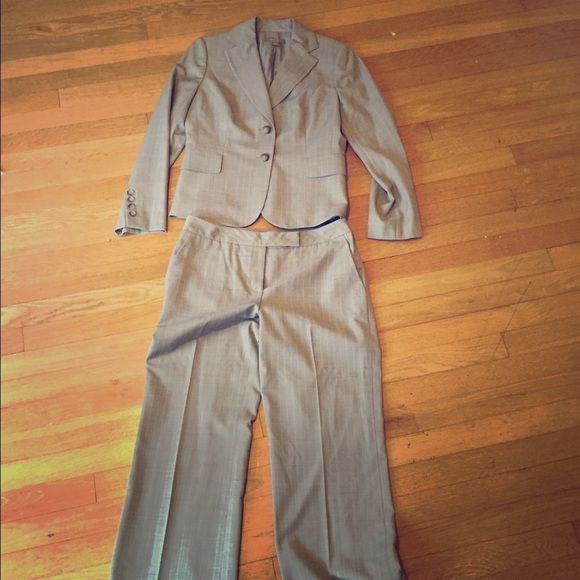 "Beautiful light grey & blue pinstripe suit Beautiful light grey Anne Taylor suit with light blue pinstripes. Hemming has been taken out, leaving a 32"" inseam. Perfect for the office. Pants are a curvy fit, and very comfortable. Jacket is 4p, pants are 4 reg Ann Taylor Jackets & Coats Blazers"