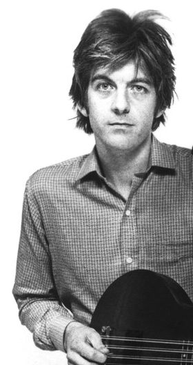 """Nick Lowe - standout British songwriter, bassist and singer and producer for Stiff Records. Member of pub rockers Brinley Schwarz, the legendary Rockpile, and one-off supergroup Little Village.  Solo career launched during new wave met with good success, especially """"Cruel To Be Kind."""""""