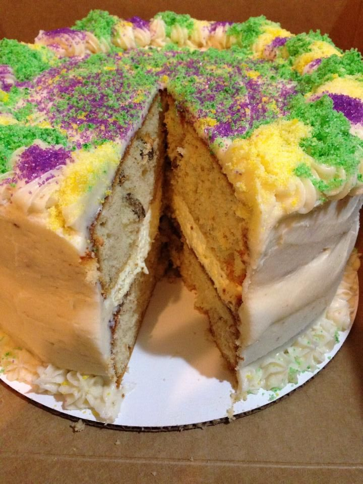 "Not your ""traditional"" King Cake by Sugar Rush, Kentwood, LA. A layer of cheesecake in between two layers of cinnamon pecan cake filled with Bavarian cream and topped with cream cheese frosting. It is pretty awesome"