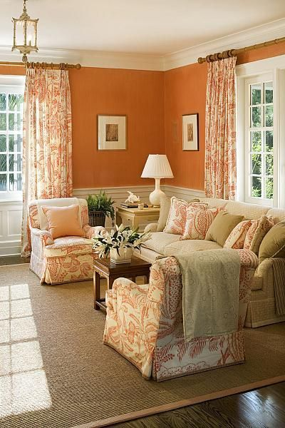 Absolutely love the Hermes orange walls, and the Manuel Canovas print club chairs, pillows, and draperies in this sitting room by Terry Sullivan on (I think) Kiawah Island, SC. The Foo Dog Ate My Homework
