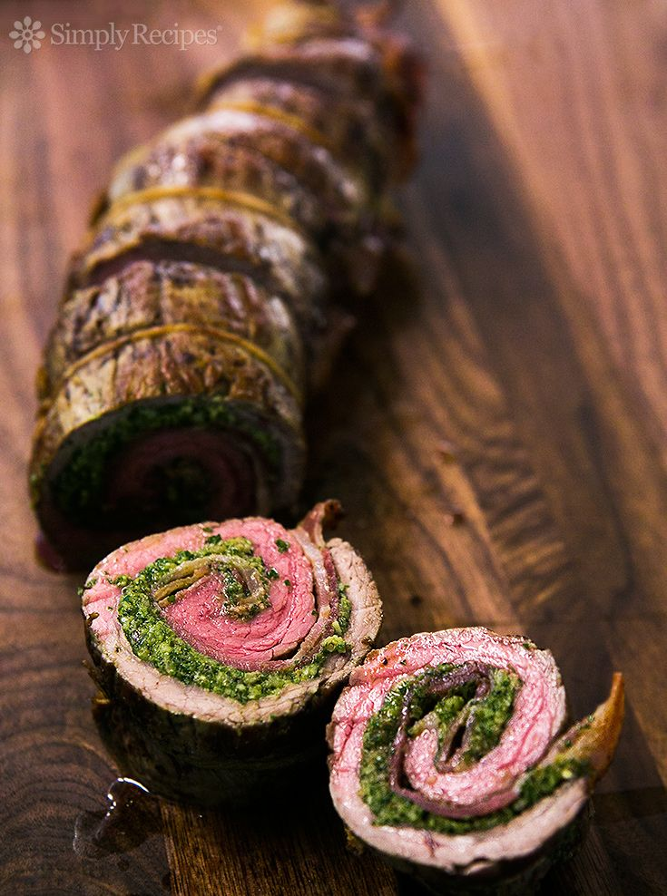 Beef Roulades with Walnut Parsley Pesto - Flank steak pounded and stuffed with pesto, wrapped in bacon, rolled into a roulade or pinwheel and roasted.