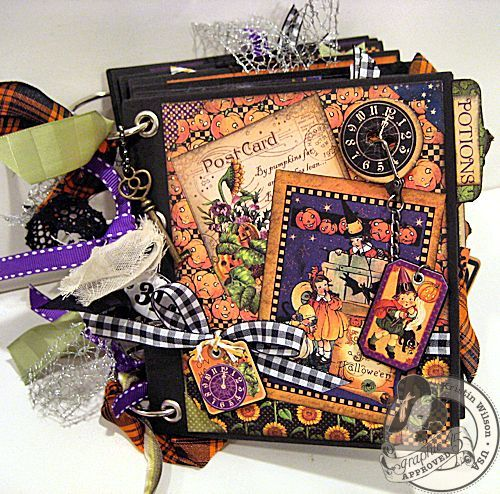 This is @Kristin Wilson's amazing Happy Haunting mini album! Love how she adds texture with her layered papers and ribbon! #graphic45