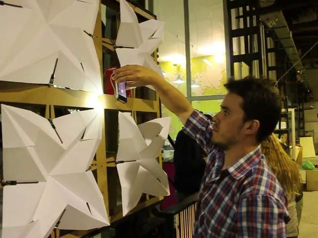 Responsive facade system | prototype 1 a sensitive facade system responding to light. the whole system works as a responsive light system. thrue the light sensor, arduino is moving four servo motors that are controlling the opening of the origami geometry.